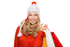 Happy woman holding shopping  bags. Winter sales. Isolated. Stock Image