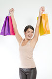 Happy woman holding shopping paper bags Royalty Free Stock Images