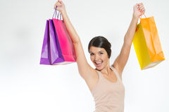 Happy woman holding shopping paper bags Stock Photography