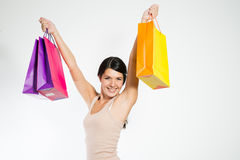 Happy woman holding shopping paper bags Stock Photo