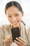 Happy Woman Holding Smart Phone Stock Photography