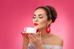 Happy Woman Holding and Smells a Cup of Tea. Pin Royalty Free Stock Photos