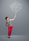 Happy woman holding smiling balloons drawing Royalty Free Stock Image