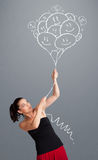 Happy woman holding smiling balloons drawing Stock Image