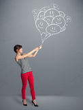 Happy woman holding smiling balloons drawing Royalty Free Stock Photos