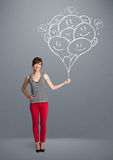 Happy woman holding smiling balloons drawing Stock Photo