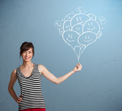 Happy woman holding smiling balloons drawing vector illustration