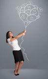 Happy woman holding smiling balloons drawing Stock Photography