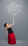 Happy woman holding smiling balloons drawing Royalty Free Stock Photo