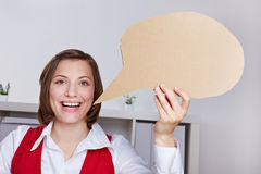 Happy woman holding speech balloon Stock Photos