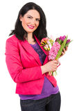 Happy woman holding spring flowers Royalty Free Stock Images