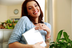 Happy woman holding tablet computer Stock Photography
