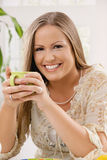 Happy woman holding tea cup Royalty Free Stock Image