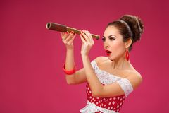 Happy Woman Holding Telescope. Pin-Up Retro style Stock Photos