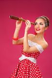 Happy Woman Holding Telescope. Pin-Up Retro style Stock Images
