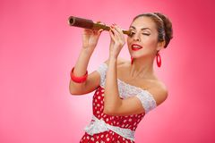 Happy Woman Holding Telescope. Pin-Up Retro style Stock Image