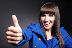 Happy woman holding thumbs up Stock Images