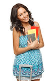 Happy woman holding tickets. Young female in casual standing with travel bag, holding passport and tickets,isolated on withe background Royalty Free Stock Photo