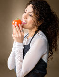 Happy woman holding tomato Royalty Free Stock Photography
