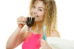 Happy woman holding toothbrush and coffee Stock Photography
