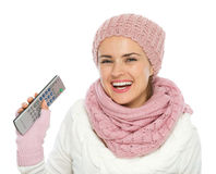 Happy woman holding TV remote control Stock Photos