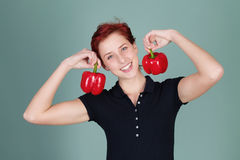 Happy woman holding two pepper bells Royalty Free Stock Images