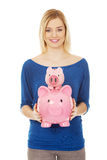 Happy woman holding two piggybanks. Stock Photography