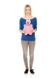 Happy woman holding two piggybanks. Stock Photo
