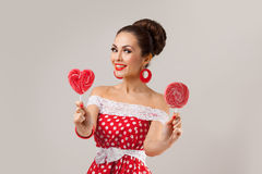 Happy Woman Holding Two Red Lollipops. Pin-up Royalty Free Stock Image