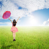 Happy Woman holding umbrella in green rice fields in sun sky Stock Photography