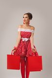 Happy Woman Holding Up Shopping Bags. Pin-up Stock Image