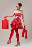 Happy Woman Holding Up Shopping Bags. Pin-up Royalty Free Stock Images