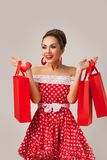 Happy Woman Holding Up Shopping Bags. Pin-up Stock Images