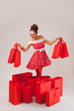 Happy Woman Holding Up Shopping Bags. Pin-up Stock Photos