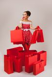 Happy Woman Holding Up Shopping Bags. Pin-up Royalty Free Stock Photo