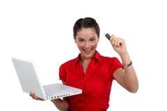 Happy woman holding USB key stock image