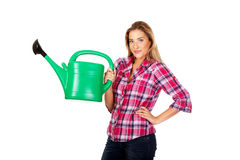 Happy woman holding a watering can Stock Photography