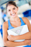 Happy woman holding  weight scale Royalty Free Stock Photo