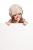 Happy woman holding a white banner Royalty Free Stock Photo