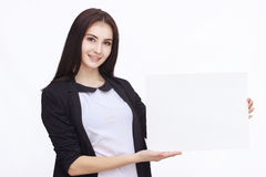 Happy woman holding white blank paper Royalty Free Stock Images