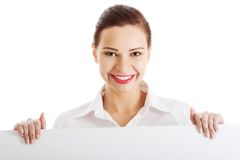 Happy woman holding white empty banner Stock Photo