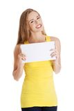 Happy woman holding white empty paper Stock Photography