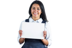Happy woman holding a white sheet of paper Royalty Free Stock Image