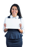Happy woman holding a white sheet of paper Royalty Free Stock Images