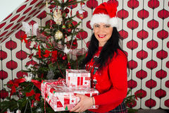 Happy woman holding Xmas gifts Royalty Free Stock Photos