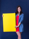 Happy woman holding a yellow blank sheet of paper Royalty Free Stock Photo