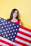 Happy woman holds american flag Royalty Free Stock Photos
