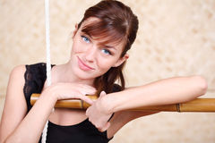 Happy woman holds on bamboo rope ladder Royalty Free Stock Photos