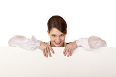 Happy woman holds blank advertisement board Stock Image