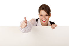 Happy woman holds blank billboard and shows thumb. Happy business woman holds blank billboard and shows thumb. Isolated on white background royalty free stock images